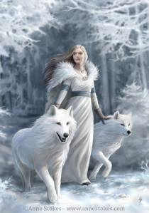 Woman with white wolves in winter